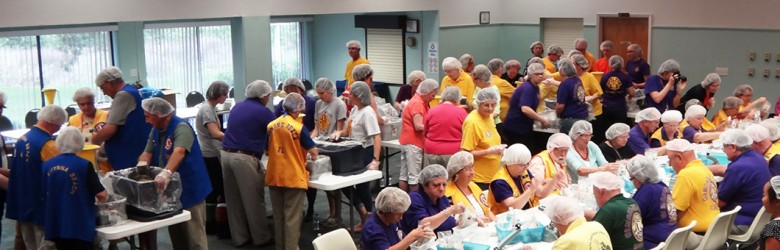 Lions Club members participating in Stop Hunger Now event